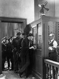 Mężczyzna czeka w linii miejsce zakłady (Wszystkie persons przedstawiający no są długiego utrzymania i żadny nieruchomość istniej zdjęcie royalty free