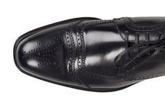 Mężczyzna czerni pojedynczy but odizolowywający Na bielu, odgórny widok fotografia royalty free