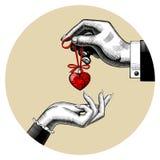 Mężczyzna daje czerwonemu zabawkarskiemu sercu w kobiety ` s ręce Zdjęcia Royalty Free