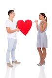 Mężczyzna daje dziewczyny sercu Zdjęcia Stock