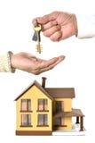 Mężczyzna daje kluczom przy miniatura domem Obraz Royalty Free
