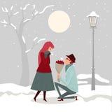 Mężczyzna daje kwiaty jego kochanek na zima dniu Zdjęcia Royalty Free
