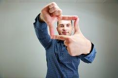 Mężczyzna dojechanie dla coś Fotografia Stock