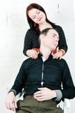 Mężczyzna dostawania ramienia masaż od jego kobiety Obrazy Stock