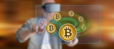Mężczyzna dotyka bitcoin waluty pojęcie Fotografia Stock