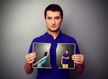 Mężczyzna drzeje fotografię para obraz royalty free