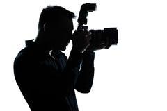 mężczyzna fotografa portreta sylwetka zdjęcie royalty free