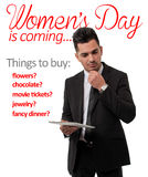 Mężczyzna główkowanie przy kobieta dnia prezenta listą Obrazy Stock