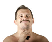 Mężczyzna golenia twarz z elektryczną żyletką Fotografia Stock