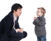 Mężczyzna i chłopiec trząść ręki odizolowywać na fotografia stock