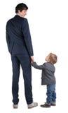 Mężczyzna i chłopiec trząść ręki odizolowywać na zdjęcie royalty free
