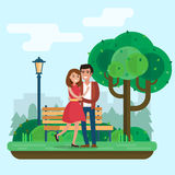 Mężczyzna i kobieta na dacie w parku z kwiatami i rowerem Obrazy Stock