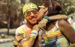Mężczyzna i kobieta przy koloru bieg Bucharest zdjęcie stock