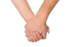 Mężczyzna i kobieta trzyma each inny ręki Obraz Royalty Free