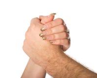 Mężczyzna i kobieta trzyma each inny ręki Fotografia Stock