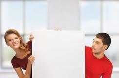 Mężczyzna i kobieta z dużą puste miejsce deską Obrazy Stock