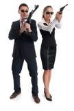Mężczyzna i kobieta z pistoletami Zdjęcia Royalty Free