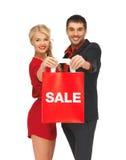Mężczyzna i kobieta z torba na zakupy Obraz Royalty Free