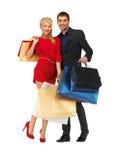 Mężczyzna i kobieta z torba na zakupy Fotografia Stock