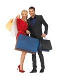 Mężczyzna i kobieta z torba na zakupy Zdjęcia Royalty Free