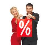 Mężczyzna i kobieta z torba na zakupy Zdjęcia Stock