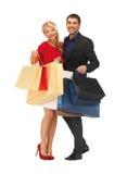 Mężczyzna i kobieta z torba na zakupy Fotografia Royalty Free