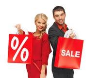 Mężczyzna i kobieta z torba na zakupy Obrazy Royalty Free
