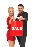 Mężczyzna i kobieta z torba na zakupy Zdjęcie Royalty Free