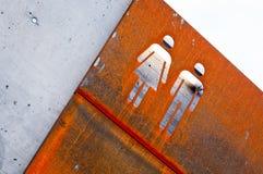 Mężczyzna i kobiety metalu stary ośniedziały znak Obraz Royalty Free