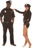 Mężczyzna i kobiety policjant ona flirtuje Zdjęcia Stock