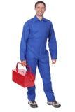 Mężczyzna jest ubranym błękitnych kombinezony obraz royalty free