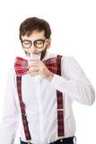 Mężczyzna jest ubranym suspenders pije mleko Obrazy Royalty Free
