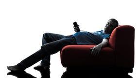 Mężczyzna kanapy leżanka pijący dosypianie zdjęcia stock