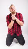 Mężczyzna klęczenie na podłoga Fotografia Stock