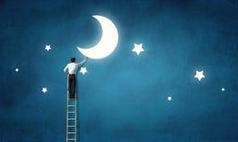 Mężczyzna które dostają księżyc Mieszani środki Obrazy Stock