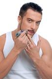 Mężczyzna młody przystojny golenie Obrazy Stock