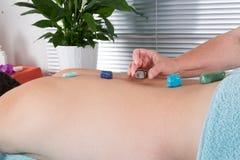 Mężczyzna ma kamiennego masaż Obrazy Royalty Free