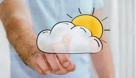 Mężczyzna macania słońca i chmury ręki rysować ikony Fotografia Royalty Free