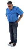 Mężczyzna martwiący się o jego nadwaga Obrazy Stock