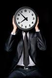 Mężczyzna mienia zegar Obraz Royalty Free