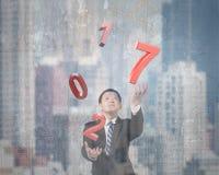 Mężczyzna miotania czerwieni chwytający 2017 słowa Obraz Stock