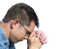 Mężczyzna modlenie na odosobnionym Białym tle zdjęcie royalty free