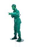 Mężczyzna na zielonym zabawkarskiego żołnierza kostiumu Obrazy Stock