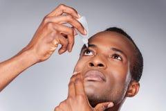 Mężczyzna obcieknięcia oko. zdjęcie royalty free