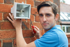 Mężczyzna ochrony Trafny światło Mieścić ścianę Obrazy Royalty Free