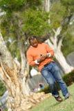 Mężczyzna Outside Wybiera numer telefon komórkowy obrazy stock