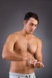 Mężczyzna po brać prysznic w pojęciu Obrazy Stock