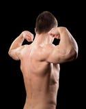 Mężczyzna pokazuje bicepsy Zdjęcia Stock