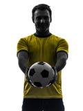 Mężczyzna pokazuje dawać piłka nożna futbolu sylwetce zdjęcia stock