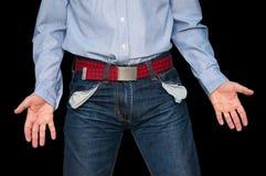 Mężczyzna pokazuje jego pustym kieszeniom demonstruje żadny pieniądze fotografia stock